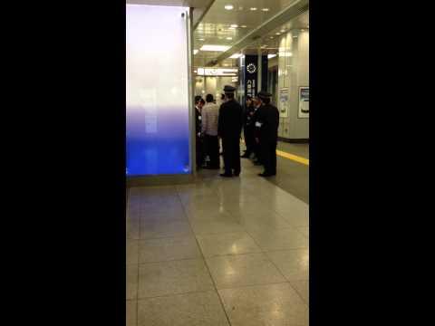 Tattooed Japanese Yakuza Mafia (wannabe) picks fight with police at Tokyo Station Japan
