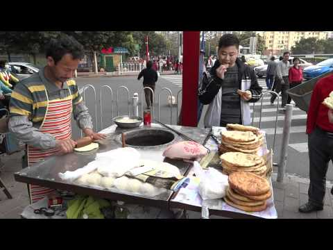 Making street food (Naan) in Guangzhou, China
