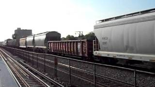 2 Union Pacific EMD SD70M's leading mixed-freight past Austin and Lake