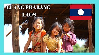 LAOS, walking through a graphic rural village. Incredible images!!!