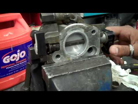 Cleaning throttle body on a TBI system. By: Zach R.