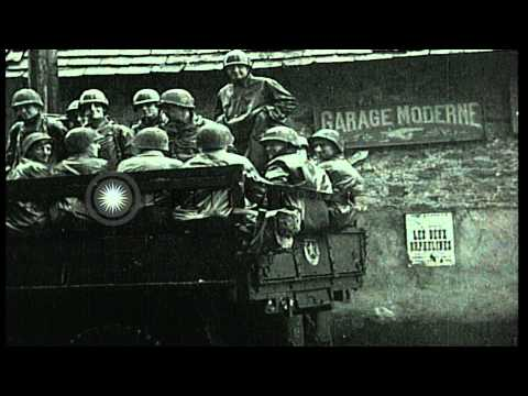 United States army troops advance through a village in France. HD Stock Footage