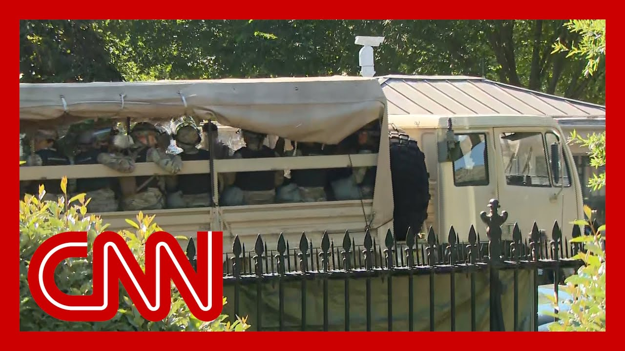 Military vehicles move outside White House amid protests