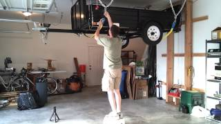 Hang my utility trailer from the garage ceiling.