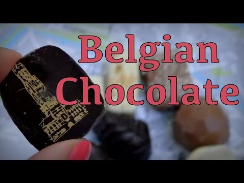 Eating delicious Belgian chocolates in Bruges
