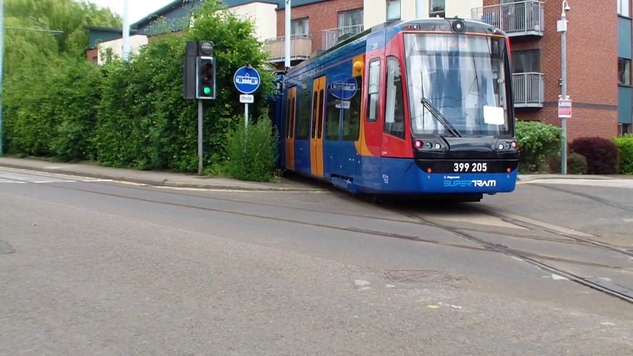 SHEFFIELD, SOUTH YORKSHIRE/UK - MAY 13, 2014: Traffic Crosses Tram ...