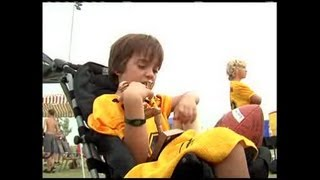 Local football team helps 9 year old boy play in the game again