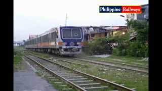 PNR DMU, passing G. Tuazon Railroad XING