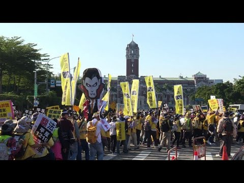 Taiwan's 'yellow vests' hit the streets of Taipei