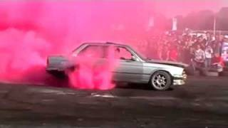 BMW doing burnout with pink smoke