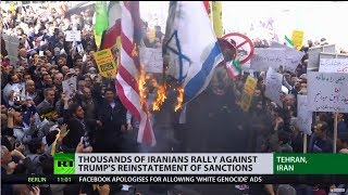 US flags set on fire as thousands of Iranians rally against Trump's reinstatement of sanctions