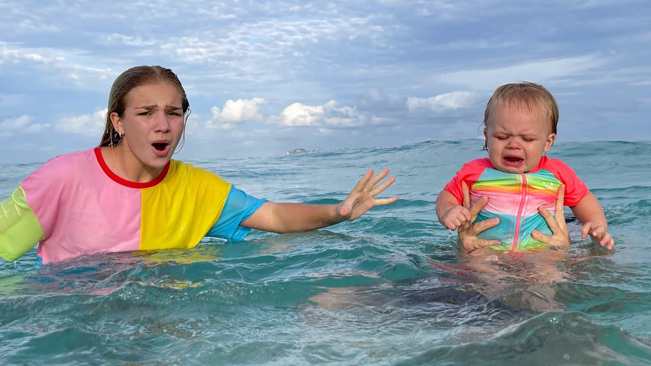 Maggie and Naomi swimming in the sea - new best series for kids