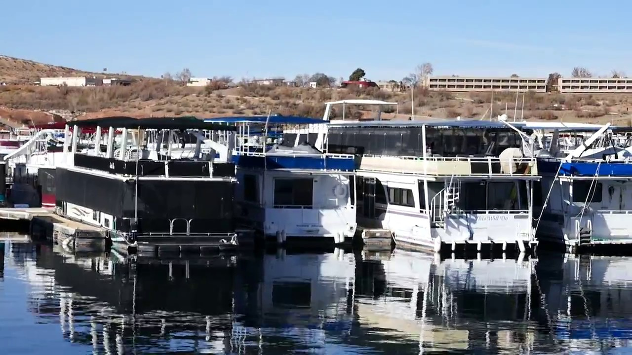 Rows Of Houseboats Parked At Wahweap Marina In Lake Powell Page