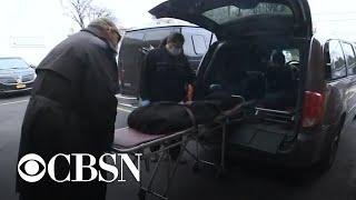 High coronavirus death toll overwhelms funeral homes