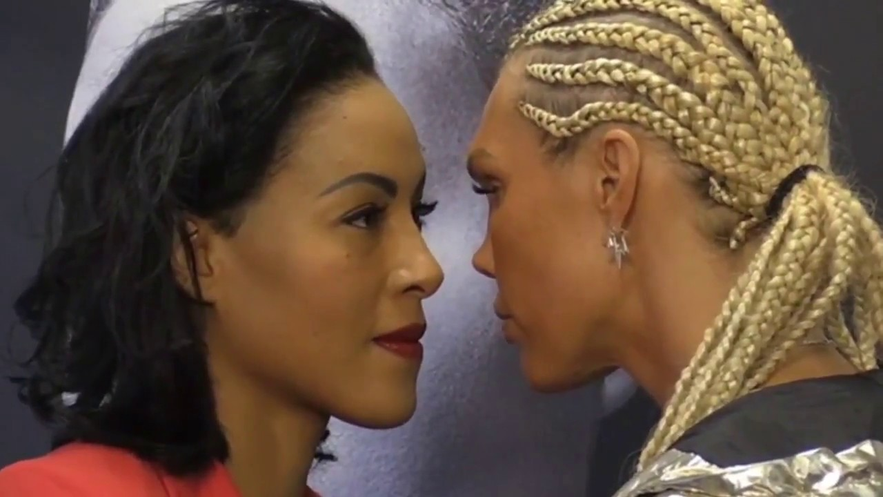 Female Boxer Goes In For The Kiss During Staredown