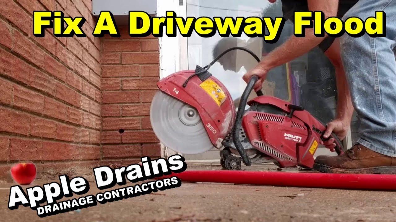 Fixing A Driveway Flood Sump Pump Cut Concrete Add Pipe
