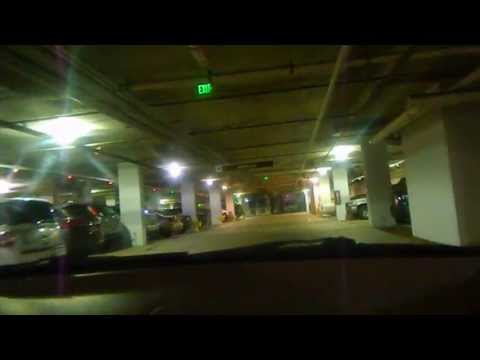 Zoe rams her car into a pillar in a parking garage