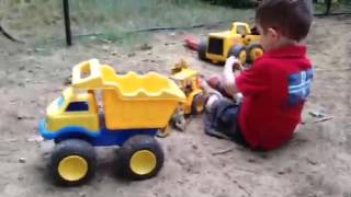 Playing in the dirt kids backhoe dump truck