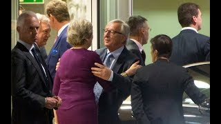 Theresa May and Jean-Claude Juncker pledge to