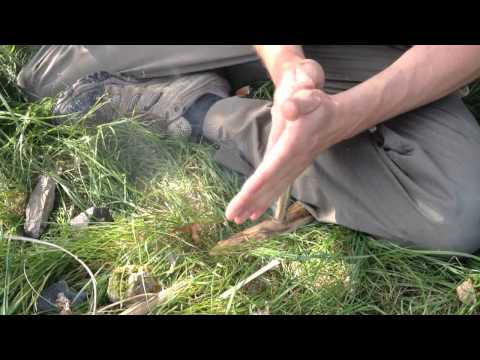Survival situation fire by friction with no knife or flint