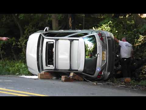 SUV Rollover In Ho-Ho-Kus Damages Pole, Trees