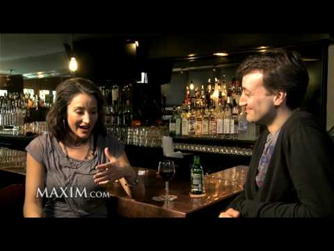 A Drink With America Olivo