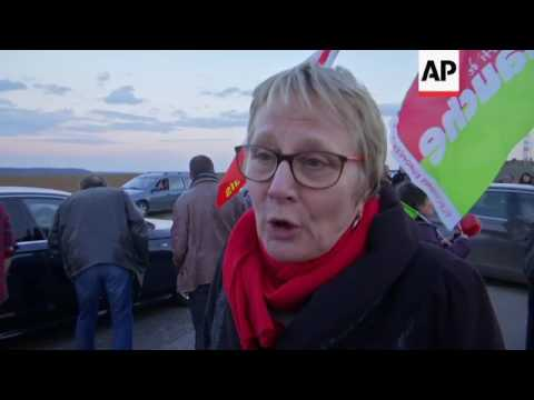 Protest at Fillon campaign rally near Paris