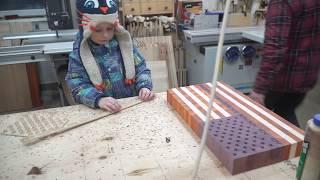 Matvei is helping to make US flag end grain cutting board