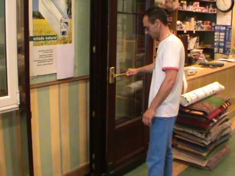 Plan renove ventanas puerta de apertura osciloparalela en for Puerta osciloparalela