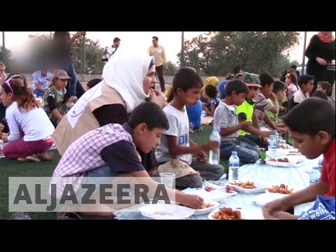 Syrians in rebel-held Douma break their fast amid rubble