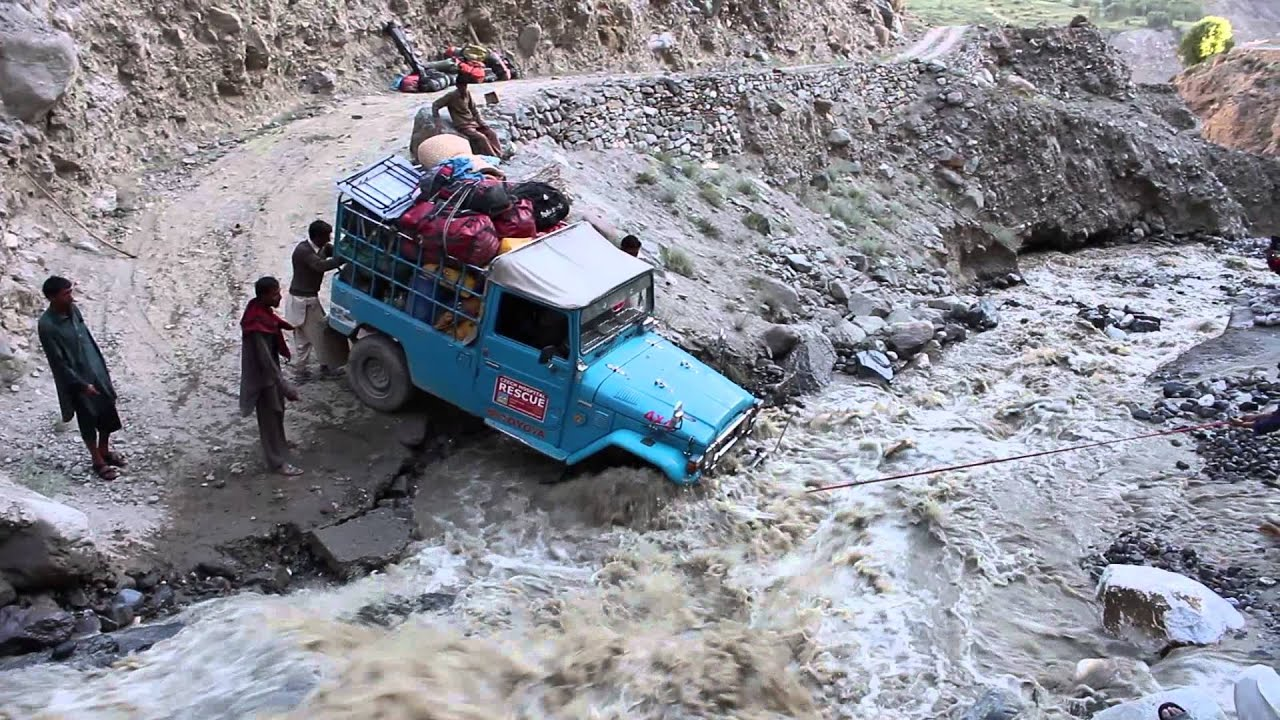 Jeep crossing creek that washed out road--Pakistani Glacial Crossing