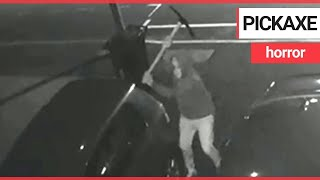 Dramatic CCTV shows yob swings pickaxe through roof of family car | SWNS TV