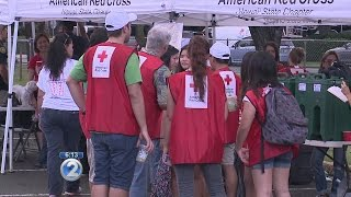 Firefighters and Red Cross volunteers offer prevention tips and free smoke alarms to Kapalama famili