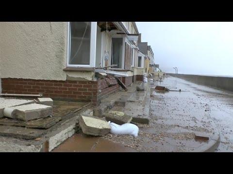 Torcross Devastation as high tides and  storm force winds crash into coastal cottages South Devon