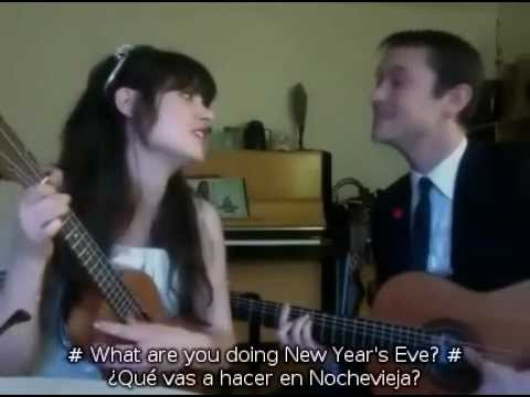 What are you doing New Years Eve - Zooey Deschanel & Joseph Gordon-Levitt (English & Spanish Lyrics)