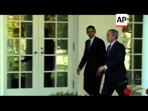 President-Elect Barak Obama and President Bush walk along the colonnade at the White House