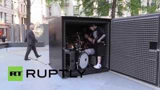 UK: Metal band rocks a black box in Gherkin art project