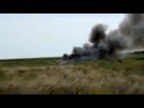 Ukrainian military plane shot down with eight on board
