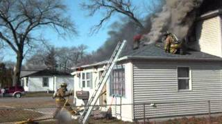 Flashover Or Backdraft Occurs While Crews Are In A Working House Fire In New Chicago.