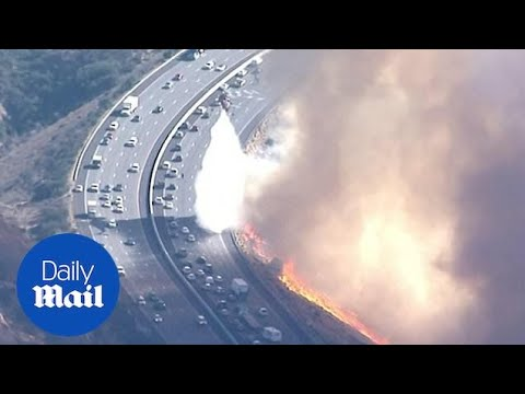 Helicopter battles new fire along Simi Valley California highway