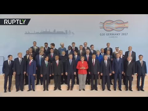 G20 leaders pose for 'family photo' in Hamburg, Trump sidelined