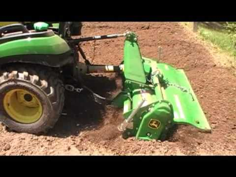 Tilling and Planting the garden 2016 using the JohnDeere 1025R