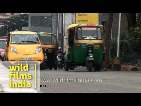 Busy traffic in Bangalore city - Tata Nano battles auto rickshaws