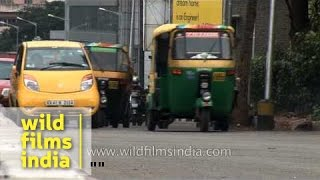 Busy traffic in Bangalore city - Tata Nano battles auto rickshaws