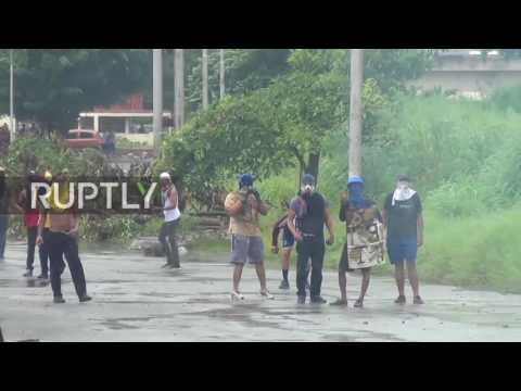 Venezuela: Masked protesters throw stones at Valencia security forces amid vote