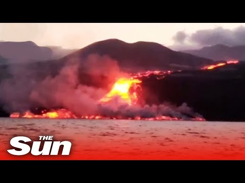 Toxic gas clouds form as La Palma volcano lava flow reaches sea plaguing locals with more danger