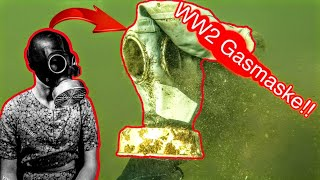 WW2 GAS MASK and HUGE Catfish found Metal Detecting underwater!! Treasure Hunting, Scuba Diving