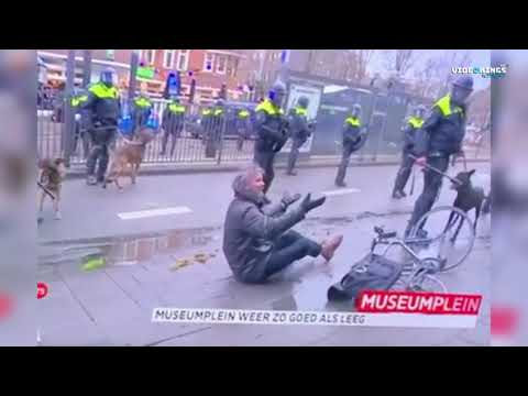WATCH: Dutch reporter pushed off his bicycle by riot police in Amsterdam