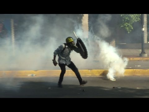 Protesters march in dogged drive against Venezuela's Maduro