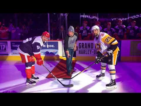 Ex-football player overcomes cancer and gets ovation from hockey crowd